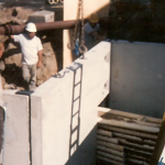 Preparing for custom manhole placement. Circa early 1980s.